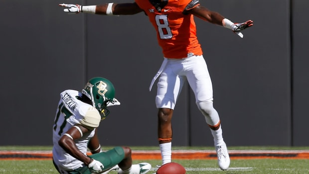 Oklahoma State's Rodarius Williams (8) was drafted by the New York Giants in the sixth round of the NFL Draft on Saturday.