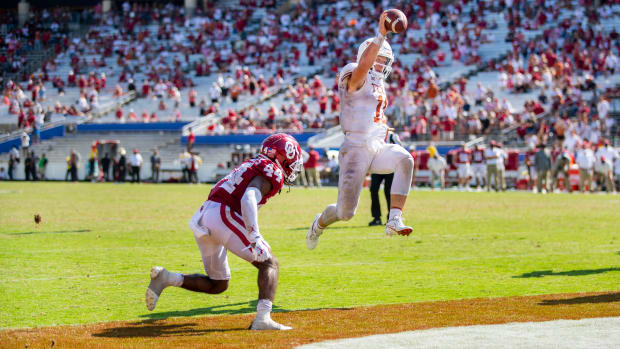 Texas Longhorns quarterback Sam Ehlinger (11) runs the ball into the end zone in overtime for a score against Oklahoma Sooners in an NCAA college football game at the Cotton Bowl in Dallas. [RICARDO B. BRAZZIELL/AMERICAN-STATESMAN] Texas Vs Ou