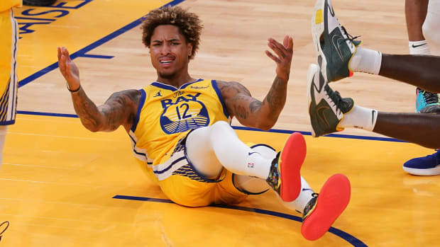 Kelly Oubre Jr. after a play with the Warriors.