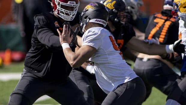 Jan 28, 2021; Mobile, Alabama, USA; National offensive lineman Adrian Ealy of Oklahoma (79) blocks National defensive lineman Elerson Smith of Northern Iowa (47) during National practice at Hancock Whitney Stadium.