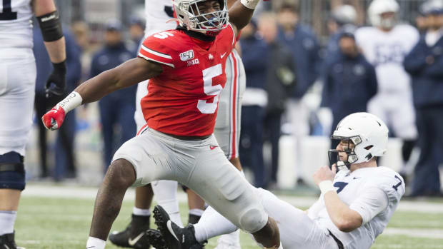 Ohio State Buckeyes linebacker Baron Browning (5) celebrates after pressuring Penn State Nittany Lions quarterback Will Levis (7) into an incomplete pass in the second half at Ohio Stadium.