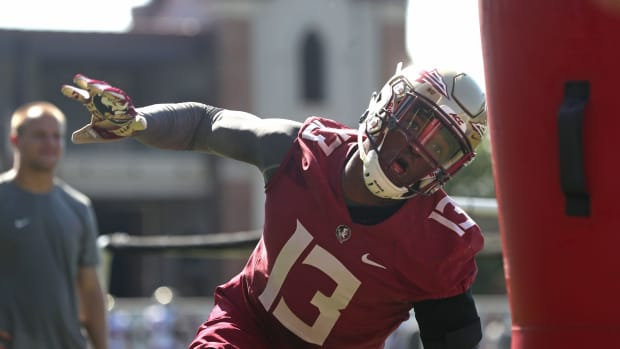 FSU's Joshua Kaindoh works out during their opening practice for fall camp at the Al Dunlap Training Facility Monday, Aug. 6, 2018. 636691563414364535-B49I3209.jpg