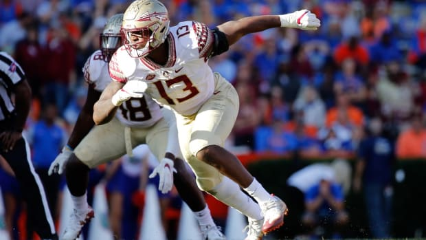 Nov 25, 2017; Gainesville, FL, USA; Florida State Seminoles defensive end Joshua Kaindoh (13) rushes during the second half at Ben Hill Griffin Stadium. Mandatory Credit: Kim Klement-USA TODAY Sports