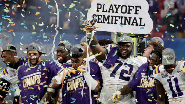 Dec 28, 2019; Atlanta, Georgia, USA; LSU Tigers nose tackle Tyler Shelvin (72) celebrates with teammates after the 2019 Peach Bowl college football playoff semifinal game between the LSU Tigers and the Oklahoma Sooners at Mercedes-Benz Stadium. Mandatory Credit: Jason Getz-USA TODAY Sports