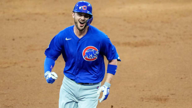 Apr 26, 2021; Cumberland, Georgia, USA; Chicago Cubs third baseman Kris Bryant (17) reacts after hitting a grand slam home run against the Atlanta Braves during the third inning at Truist Park.