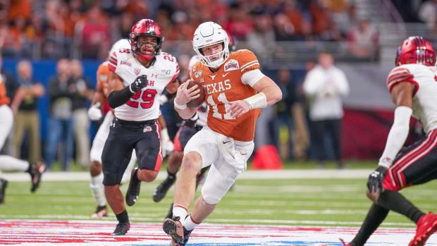 Dec 31, 2019; San Antonio, Texas, USA; Texas Longhorns quarterback Sam Ehlinger (11) runs the ball against the Utah Utes in the second half at the Alamodome. Mandatory Credit: Daniel Dunn-USA TODAY Sports