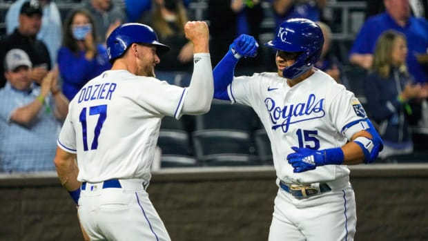 Kansas City Royals second baseman Whit Merrifield (15) is congratulated by third baseman Hunter Dozier (17) after hitting a home run against the Cleveland Indians during the fourth inning at Kauffman ...