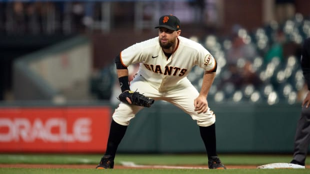 Apr 27, 2021; San Francisco, California, USA; San Francisco Giants first baseman Brandon Belt awaits the next pitch against the Colorado Rockies during the fifth inning at Oracle Park.