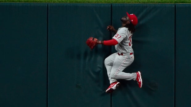 Apr 28, 2021; St. Louis, Missouri, USA; Philadelphia Phillies center fielder Odubel Herrera (37) slams in to the wall as he watches a home run hit by St. Louis Cardinals first baseman Paul Goldschmidt (not pictured) during the third inning at Busch Stadium. Mandatory Credit: Jeff Curry-USA TODAY Sports