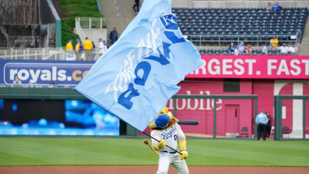 May 5, 2021; Kansas City, Missouri, USA; The Kansas City Royals mascot Sluggerrr waves a flag before the game against the Cleveland Indians at Kauffman Stadium. Mandatory Credit: Denny Medley-USA TODAY Sports