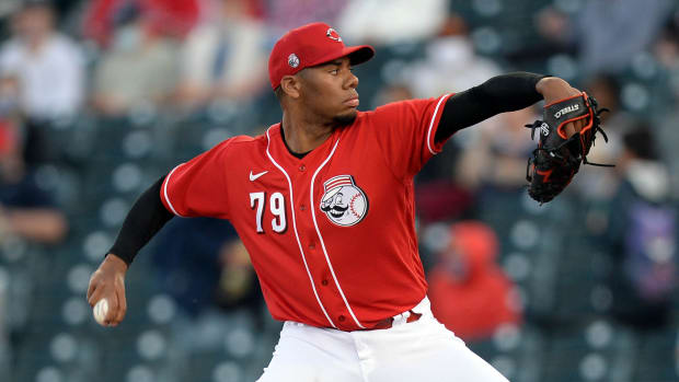Reds' Hunter Greene delivers a pitch
