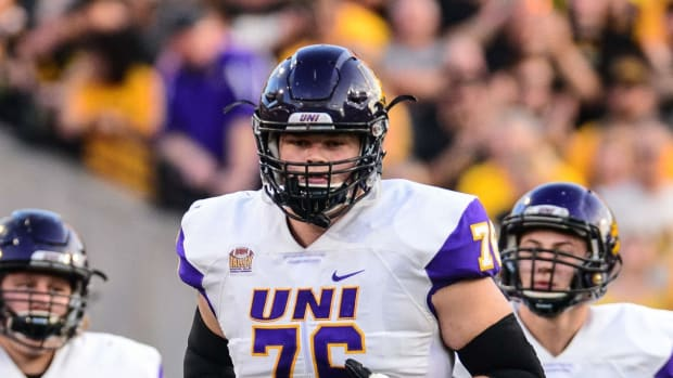 Northern Iowa Panthers offensive lineman Spencer Brown (76) and teammates enter the field before the game against the Iowa Hawkeyes at Kinnick Stadium.