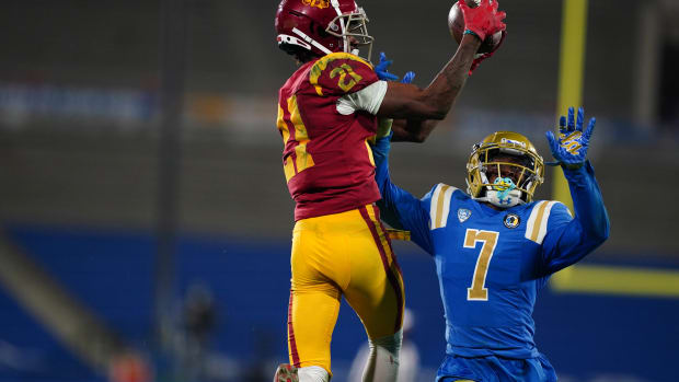 Dec 12, 2020; Pasadena, California, USA; Southern California Trojans wide receiver Tyler Vaughns (21) is defended by Southern California Trojans safety Chase Williams (7) on a 35-yard reception in the final minute at Rose Bowl.USC defeated UCLA 43-38.