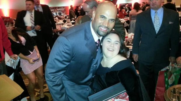 Albert Pujols and Alex Tuchowski at the Pujols Family Foundation's O' Night Divine event in St. Louis in December 2012.