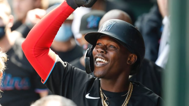Miami Marlins second baseman Jazz Chisholm Jr. (2) is congratulated in the dugout after hitting a home run against the New York Mets during the second inning at Citi Field.