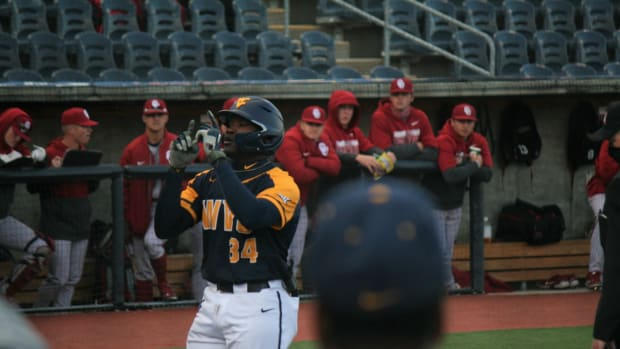 Paul McIntosh crosses home plate after launching a 453ft home run.
