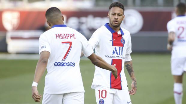 Neymar celebrating with Kylian Mbappé