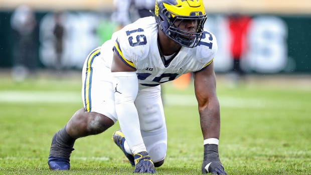 Oct 20, 2018; East Lansing, MI, USA; Michigan Wolverines defensive lineman Kwity Paye (19) prepares for the snap of the ball during the second half of a game against the Michigan State Spartans at Spartan Stadium. Mandatory Credit: Mike Carter-USA TODAY Sports