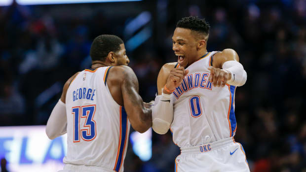 Feb 11, 2019; Oklahoma City, OK, USA; Oklahoma City Thunder guard Russell Westbrook (0) and forward Paul George (13) celebrate after Westbrook hit a three-point basket during the second half at Chesapeake Energy Arena. Oklahoma City won 120-111. Mandatory Credit: Alonzo Adams-USA TODAY Sports