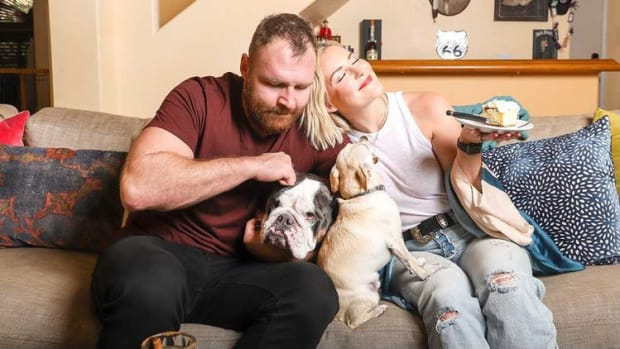 Renee Paquette (formerly Renee Young) poses with husband Jon Moxley