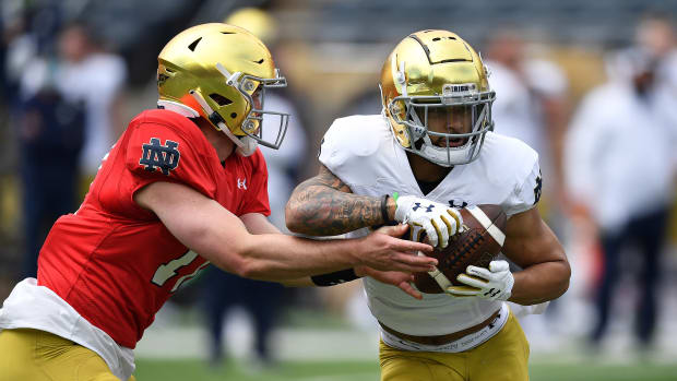 Notre Dame's Jack Coan hands the ball off to Kyren Williams in spring camp