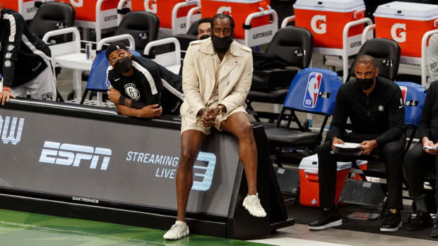 Nets star James Harden sitting on the sidelines