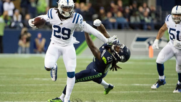 Oct 1, 2017; Seattle, WA, USA; Indianapolis Colts free safety Malik Hooker (29) stiff arms Seattle Seahawks cornerback DeAndre Elliott (21) as he runs back an interception during the second half at CenturyLink Field. The Seahawks won 46-18.