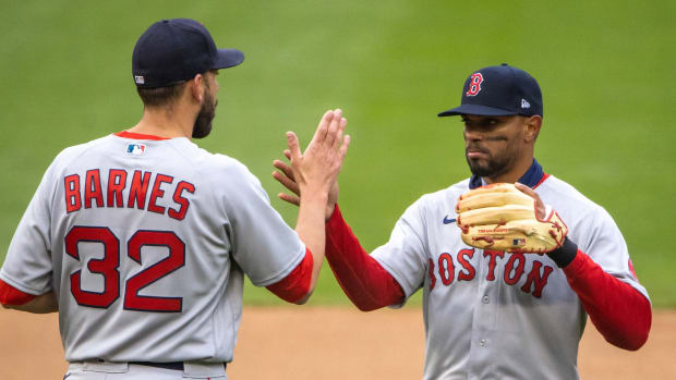 Boston Red Sox shortstop Xander Bogaerts (2) celebrates with relief pitcher Matt Barnes (32) after defeating the Minnesota Twins at Target Field.