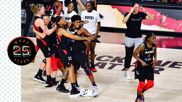 The Las Vegas Aces hug and celebrate on the court.