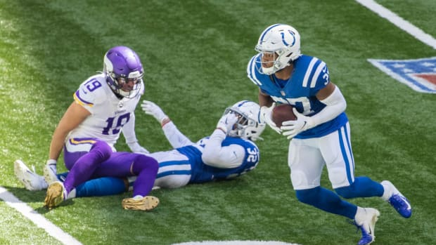 Sep 20, 2020; Indianapolis, Indiana, USA; Indianapolis Colts safety Khari Willis (37) intercepts the ball in the first half against the Minnesota Vikings at Lucas Oil Stadium.