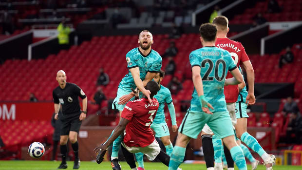 Eric Bailly lunges catching Nat Phillips in Liverpool's 4-2 win over Manchester United in the Premier League.