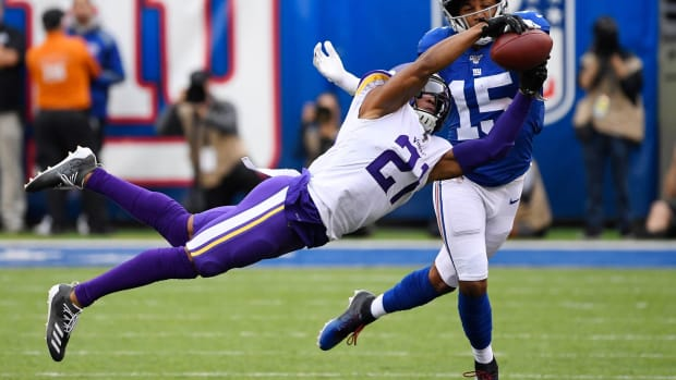 Oct 6, 2019; East Rutherford, NJ, USA; Minnesota Vikings cornerback Mike Hughes (21) breaks up a pass intended for New York Giants wide receiver Golden Tate (15) in the first half at MetLife Stadium. Mandatory Credit: Robert Deutsch-USA TODAY Sports