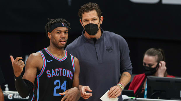 Sacramento Kings guard Buddy Hield and coach Luke Walton