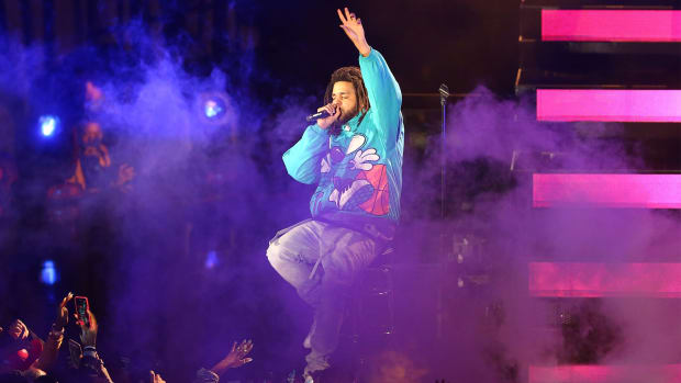 Feb 17, 2019; Charlotte, NC, USA; Recording artist J Cole performs during the half-time show at the All Star Game at Spectrum Center.