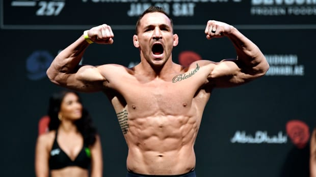UFC's Michael Chandler flexes at a weight-in