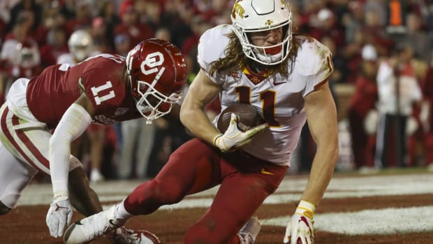 Nov 9, 2019; Norman, OK, USA; Iowa State Cyclones tight end Chase Allen (11) catches a touchdown pass past Oklahoma Sooners cornerback Parnell Motley (11) during the fourth quarter at Gaylord Family - Oklahoma Memorial Stadium. Mandatory Credit: Kevin Jairaj-USA TODAY Sports