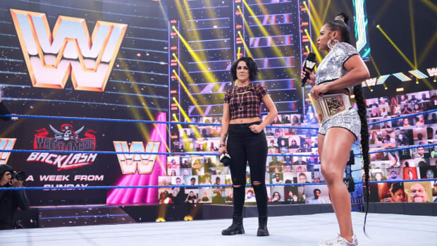 WWE's Bianca Belair and Bayley in the ring with microphones on SmackDown