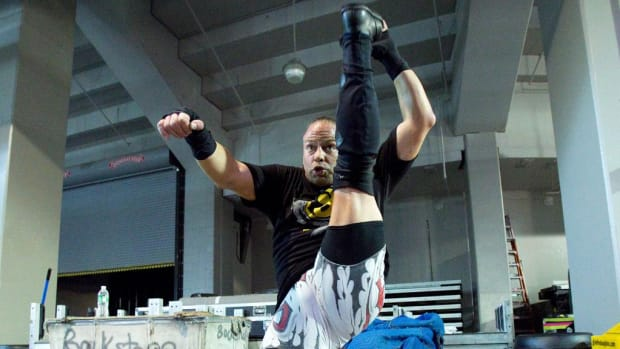 WWE wrestler Rob Van Dam stretches in anticipation of a match