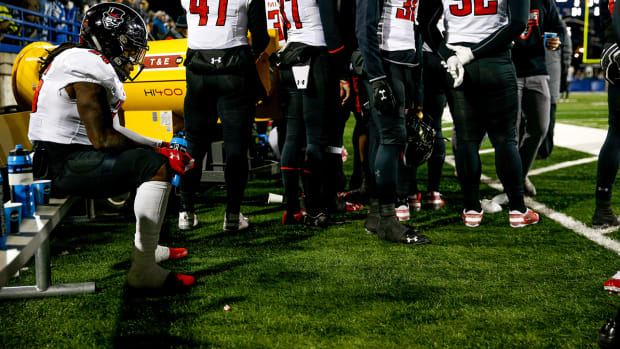 Juantarius Bryant sits on the bench in a FCS playoff game between the Austin Peay Governors and Montana State Bobcats.