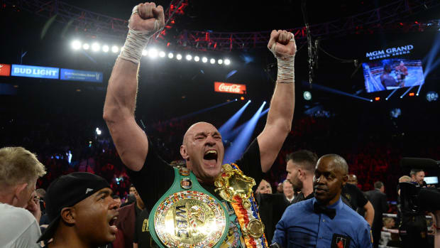 Tyson Fury celebrates WBC title.