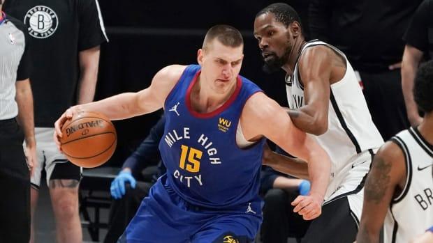 Nikola Jokic controls the ball against Brooklyn Nets forward Kevin Durant