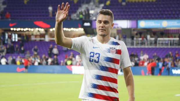 USMNT defender Aaron Long coming off the field.