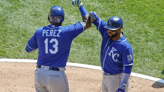 May 14, 2021; Chicago, Illinois, USA; Kansas City Royals catcher Salvador Perez (13) celebrates with first baseman Carlos Santana (41) after hitting a three-run home run against the Chicago White Sox during the third inning of the first game of a doubleheader at Guaranteed Rate Field. Mandatory Credit: Kamil Krzaczynski-USA TODAY Sports