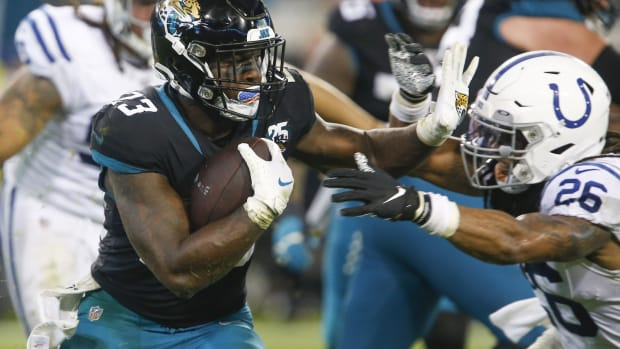 Dec 29, 2019; Jacksonville, Florida, USA; Jacksonville Jaguars running back Ryquell Armstead (23) rushes against Indianapolis Colts safety Clayton Geathers (26) during the second half at TIAA Bank Field.