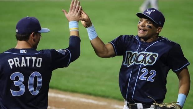 Wilmington's Tyler Hill is greeted by Nick Pratto after Hill made a running catch on a deep drive in the eighth inning of the Blue Rocks' 5-4 win in the second game of the Mils Cup Championship Series Wednesday at Frawley Stadium. Bluerocks 5 Fayetteville 4