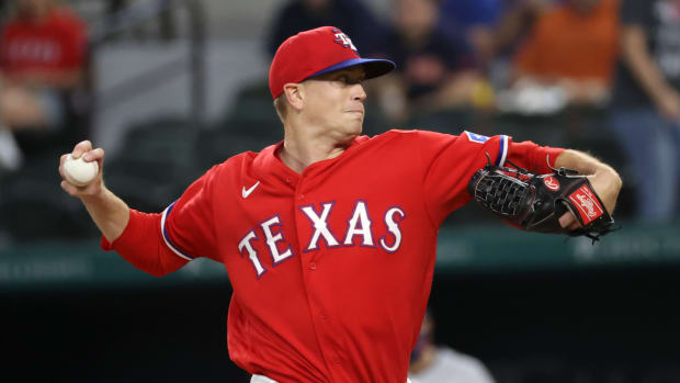 May 21, 2021; Arlington, Texas, USA; Texas Rangers starting pitcher Kyle Gibson (44) throws during the first inning against the Houston Astros at Globe Life Field.