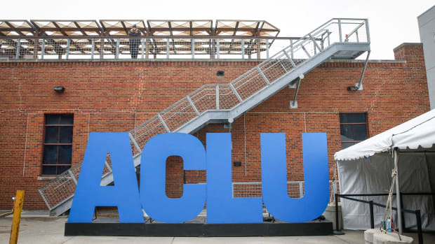 Giant letters spell out ACLU during the program's 100th year celebration event at Des Moines Social Club in Des Moines.