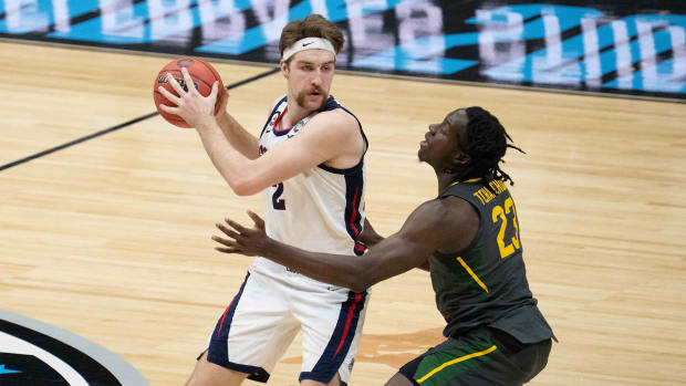 April 5, 2021; Indianapolis, IN, USA; Gonzaga Bulldogs forward Drew Timme (2) controls the basketball against Baylor Bears forward Jonathan Tchamwa Tchatchoua (23) in the first half during the national championship game in the Final Four of the 2021 NCAA Tournament at Lucas Oil Stadium.