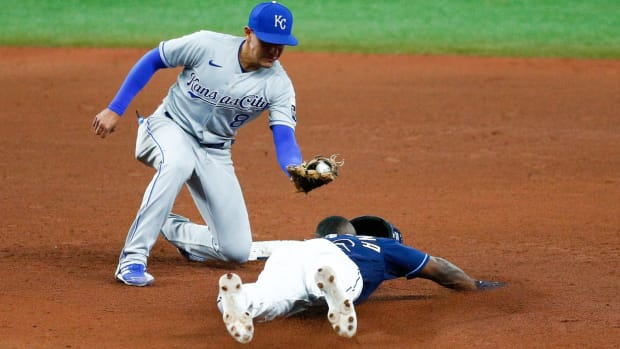 May 26, 2021; St. Petersburg, Florida, USA; Tampa Bay Rays left fielder Randy Arozarena (56) is caught stealing in the fifth inning by Kansas City Royals second baseman Nicky Lopez (8) at Tropicana Field. Mandatory Credit: Nathan Ray Seebeck-USA TODAY Sports