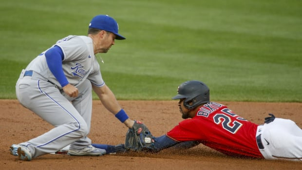 Apr 30, 2021; Minneapolis, Minnesota, USA; Minnesota Twins center fielder Byron Buxton (25) just beats the throw to steal second base as Kansas City Royals second baseman Whit Merrifield (15) applies the tag in the first inning at Target Field. Mandatory Credit: Bruce Kluckhohn-USA TODAY Sports